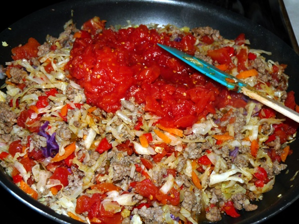 Add two cans of Rotel or diced tomatoes and a little sriracha or cayenne.
