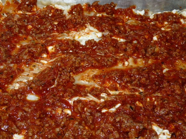 Spread 1/3 of the meat sauce