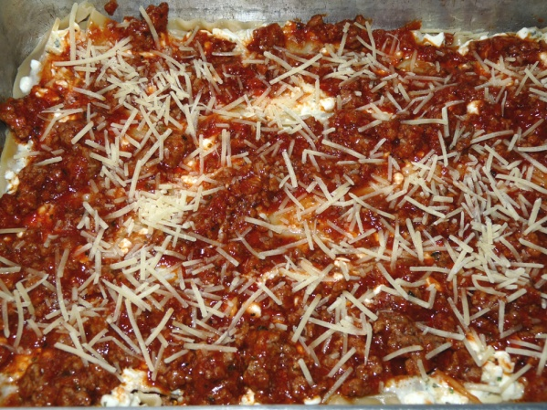 Sprinkle with 1/2 of the remaining Parmesan