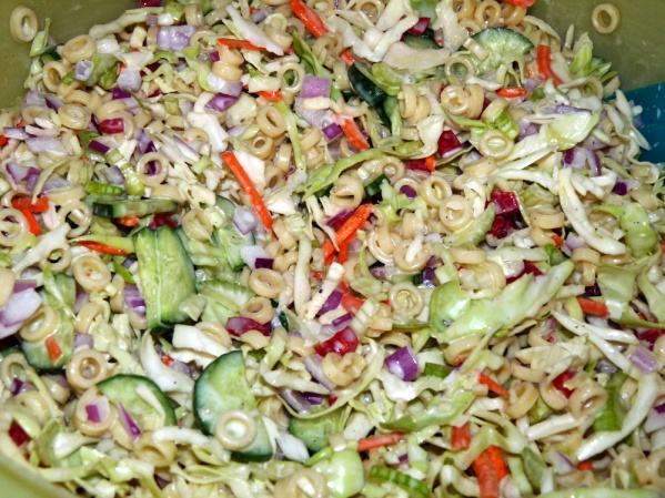 Add dressing to vegetables and mix well