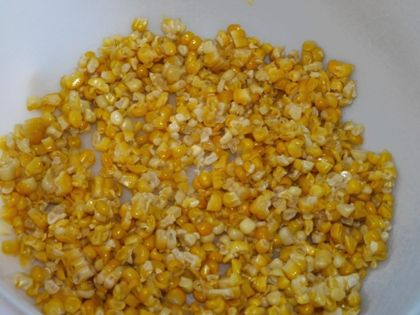 Add corn to large bowl