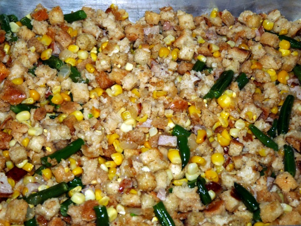 Add contents of skillet to bowl of stuffing and stir well.
