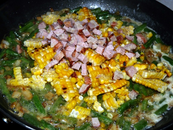 Stir in corn and diced sausage and cook until bubbling again.