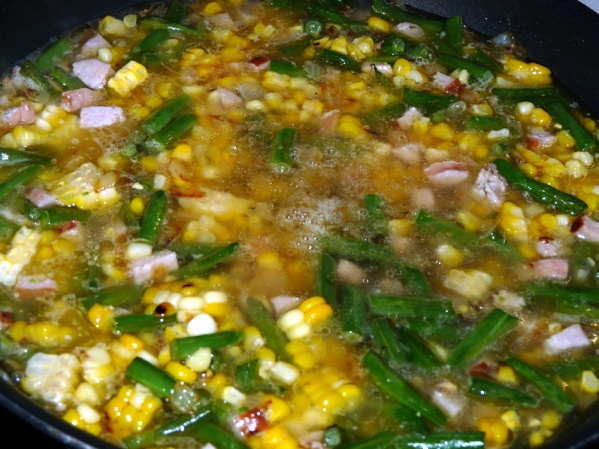 Add chicken broth and again cook until bubbling.