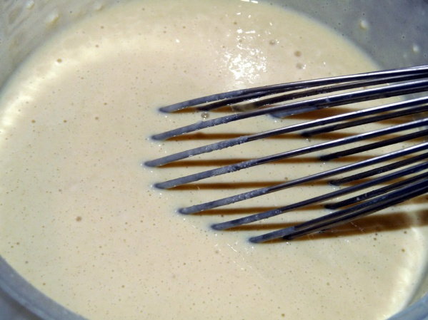 Beat with a whisk until only small lumps remain.