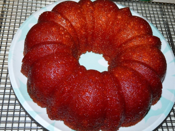 Loosen edges of pan with a paring knife. Place plate on top of bundt pan and turn. Cake will fall out of pan.