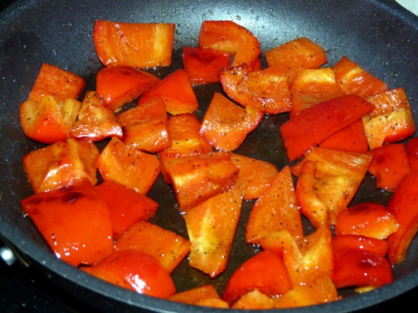 Sauté peppers over medium high heat with a drizzle of oil until beginning to soften.