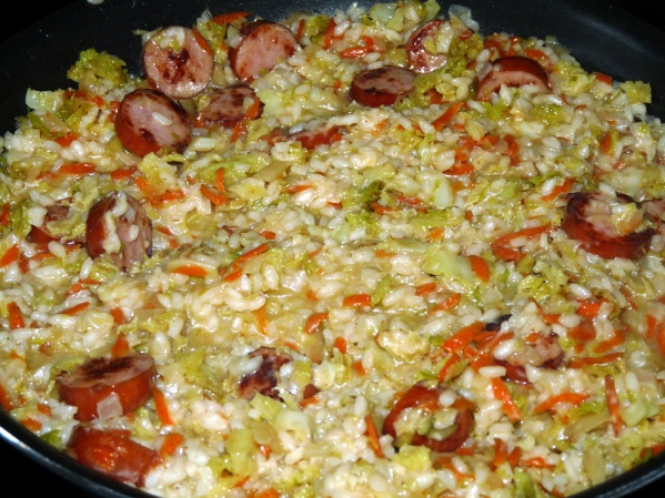 Let risotto simmer for several minutes. Taste test for seasoning and serve hot.