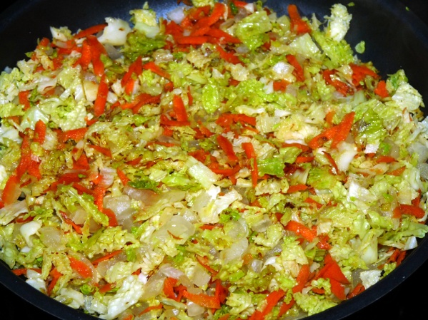 Prepare condimenti: sauté onions and carrots in olive oil for several minutes. Add savoy cabbage and marjoram and sauté until cabbage is al dente to your preference.