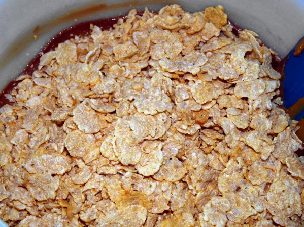 Add cereal to melted choclate and stir to coat.