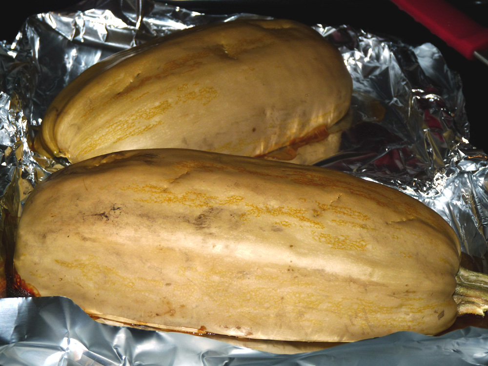 Cut squash in half and place cut side down on a foil covered baking sheet. Roast for an hour or until a fork easily pierces the shell