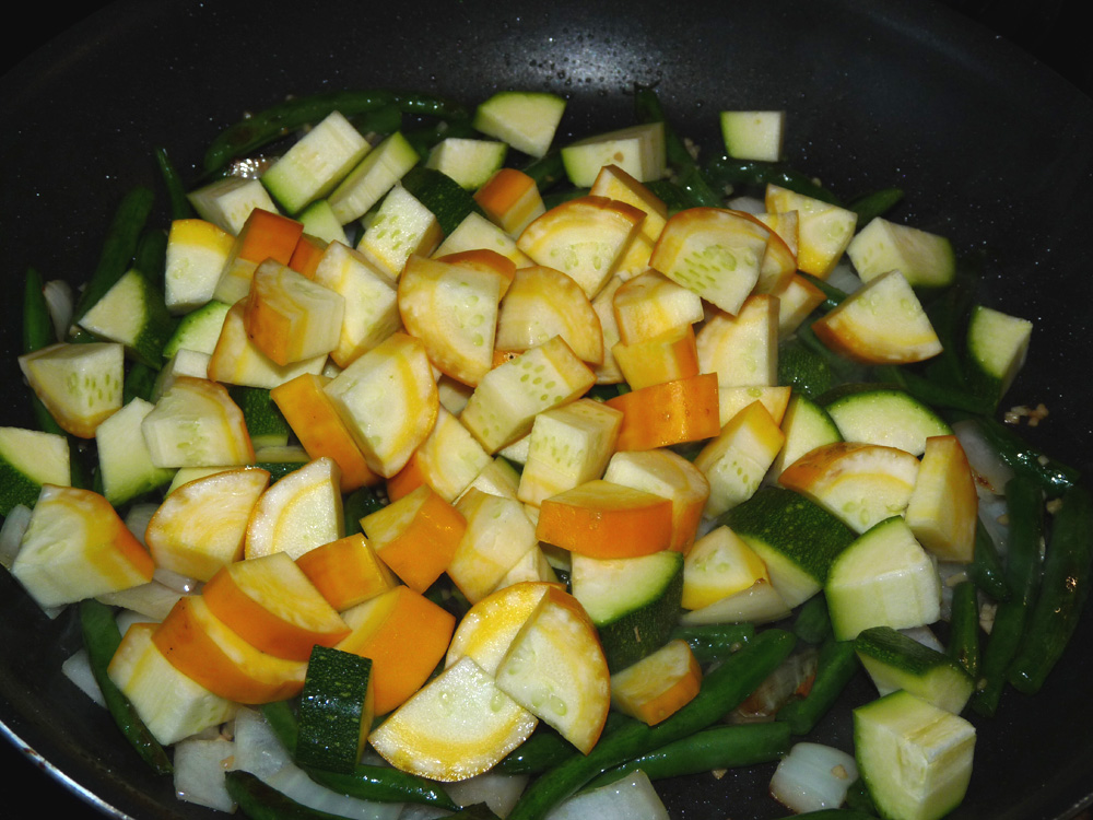 Stir in zucchini and summer squash and continue to fry, stirring occasionally, until the squash begins to soften.
