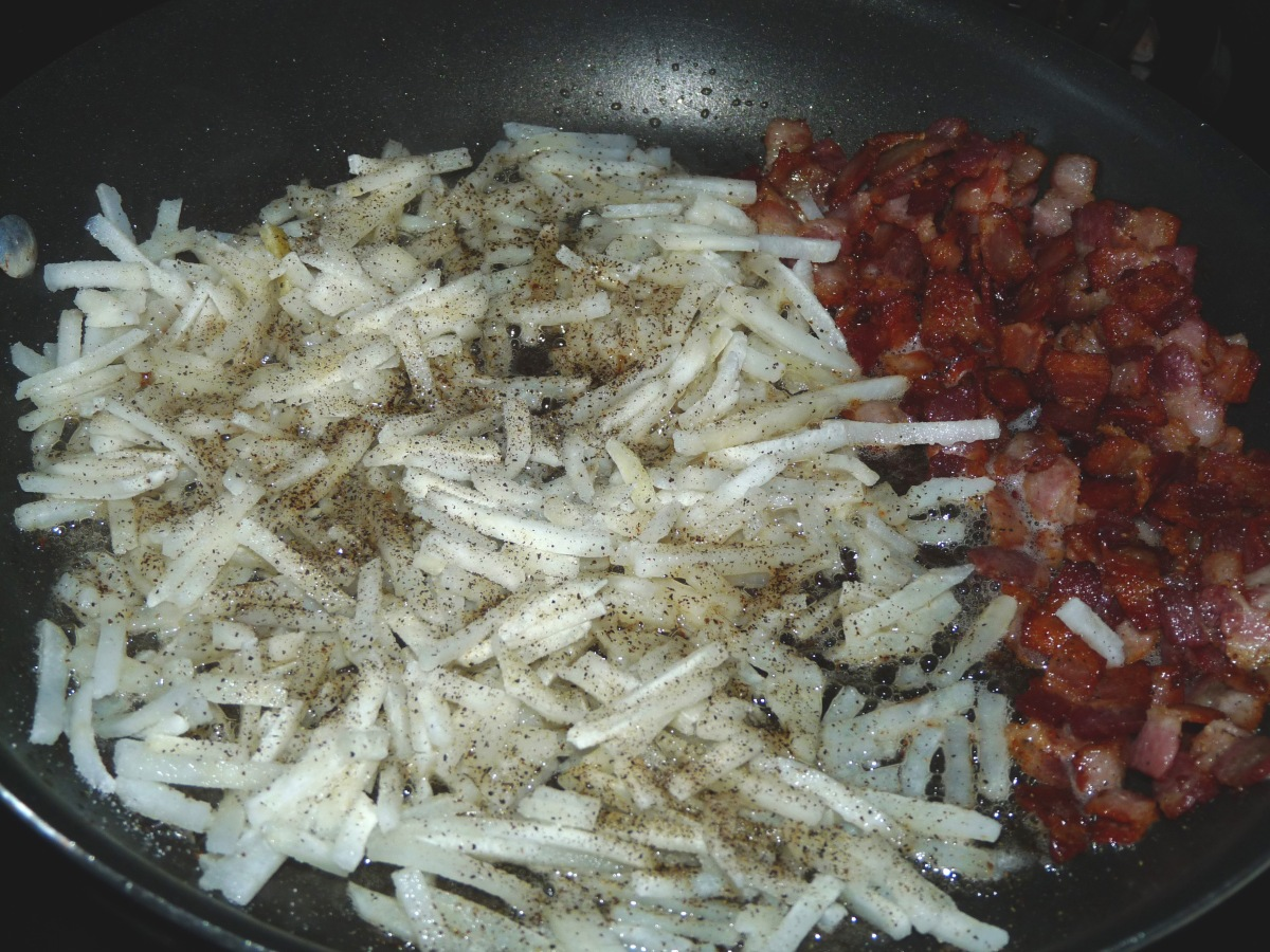 Push bacon aside and fry hash browns until browned and crispy.