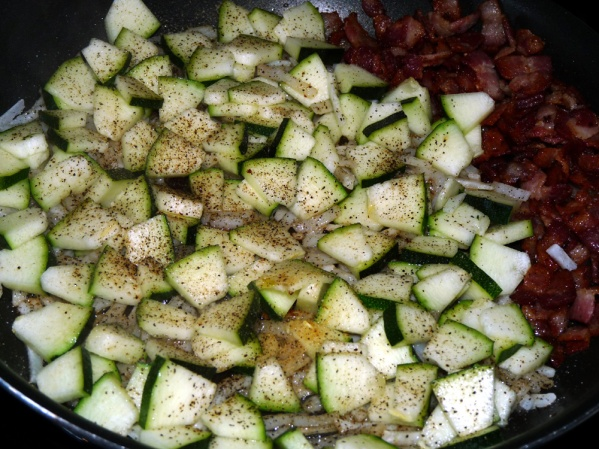 Add zucchini pieces and fry until lightly browned in places, stirring occasionally