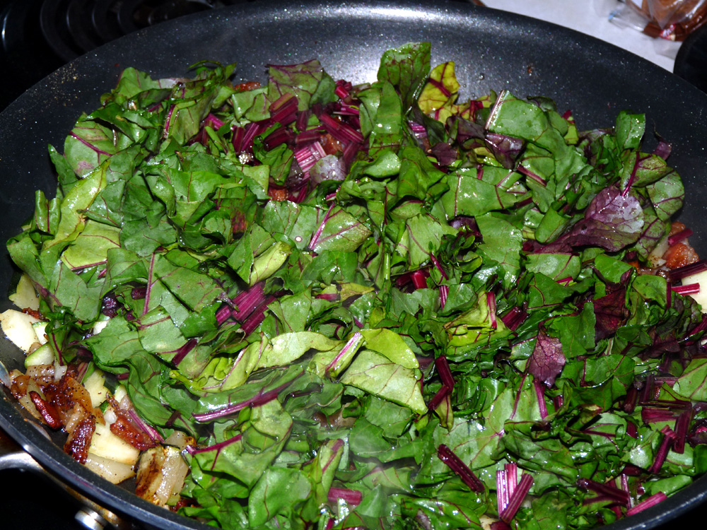 Fry beet greens and stems until wilted and stems begin to soften. You want a slight texture to the stems yet.