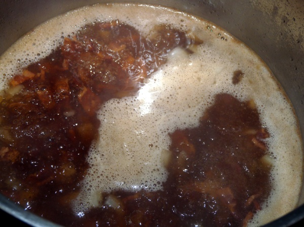 Add a little of the broth and scrape the browned bits from the bottom of the pot.