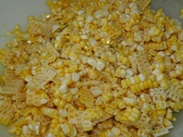 Cut corn from cobs.