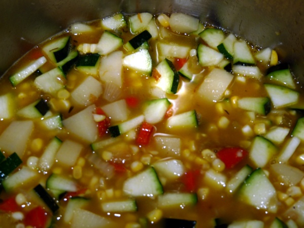 Add corn and zucchini and simmer until heated through.
