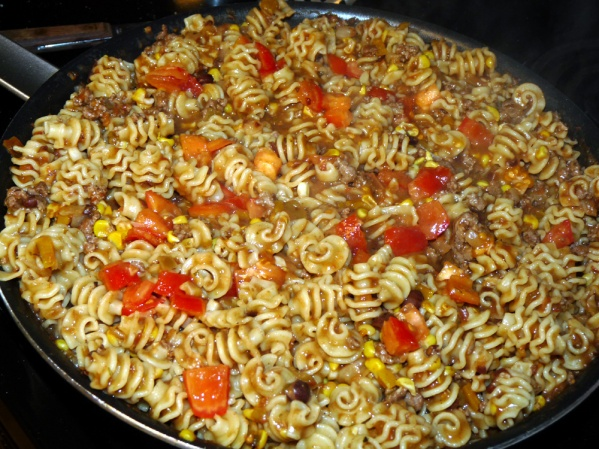 Cook several minutes to allow the pasta to absorb the sauce. Add pasta water in small increments if it gets too dry. Stir in tomatoes, reserving some for garnish.