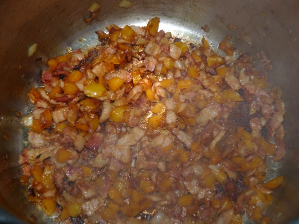 Sauté bacon until almost browned. Add onion and pepper and sauté until onion is browned around the edges.
