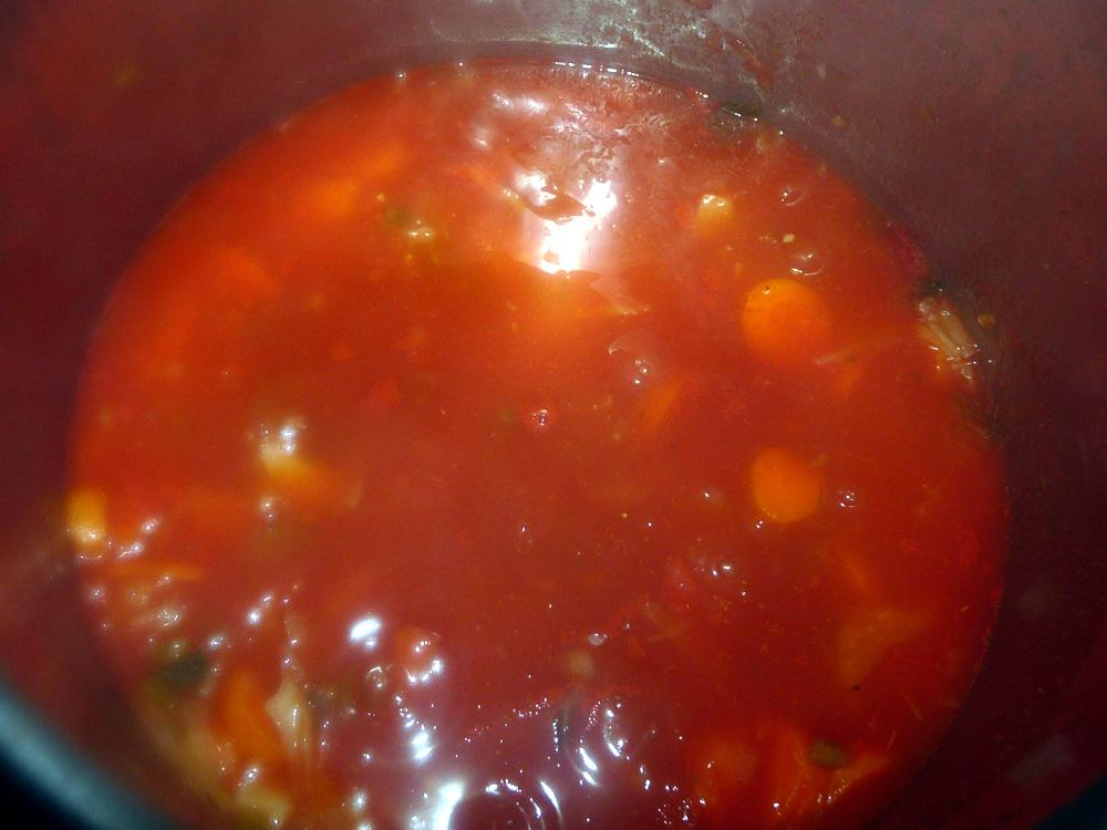 Add can of tomato puree.