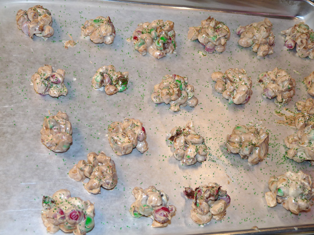 Using a small cookie scoop, drop small portions onto a wax paper lined baking sheet. Sprinkled with colored sugar or sprinkles if desired. Firm up in freezer for several minutes then layer in a container. Cover.