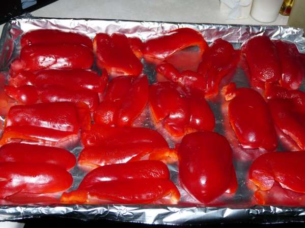 Cut peppers into pieces and remove ribs and seeds. Spread on foil covered baking pan.