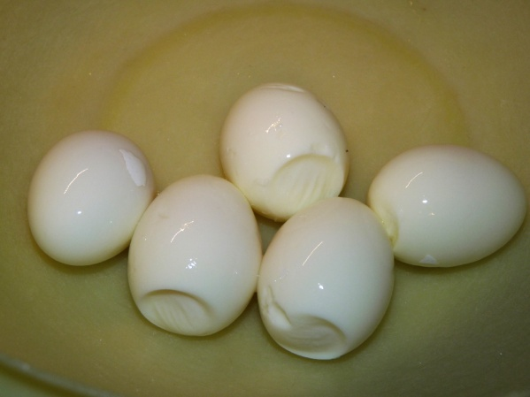 Boil eggs, let cool and peel.