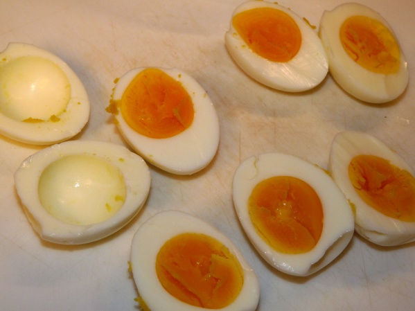 Cut eggs in half lengthwise. Remove yolks into a bowl.