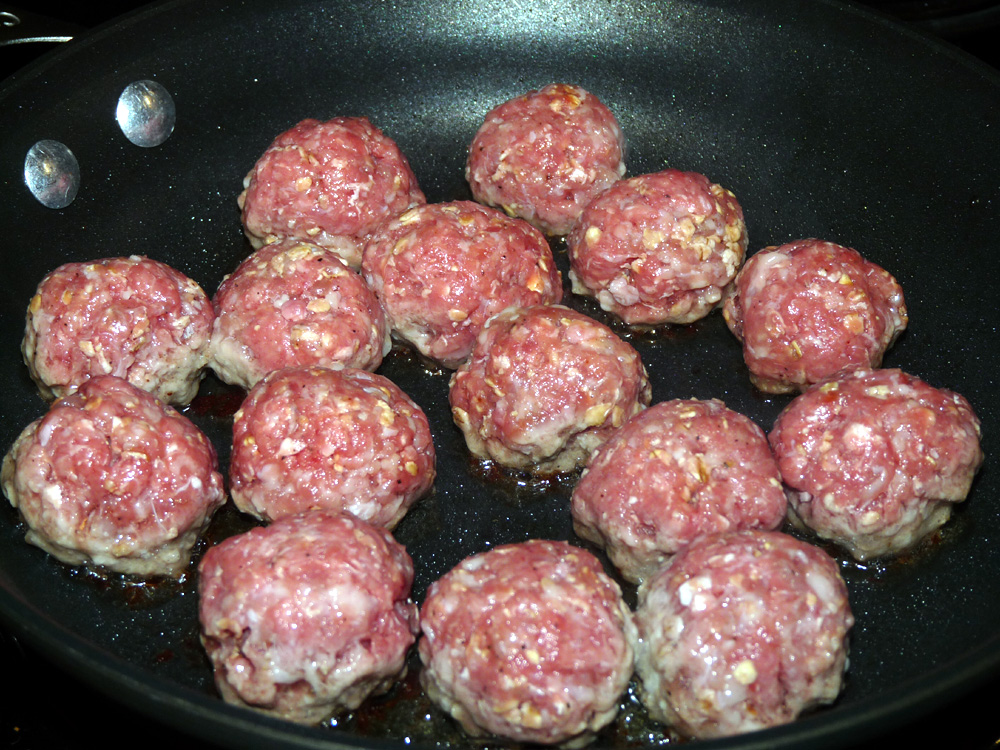 Sear meatballs a few at a time in a skillet.