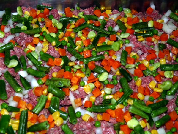 Rinse frozen vegetables and spread evenly in pan.