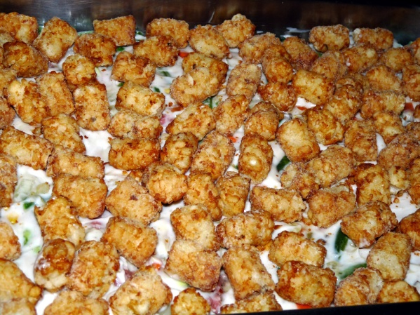 Spread tater tots over the top.
