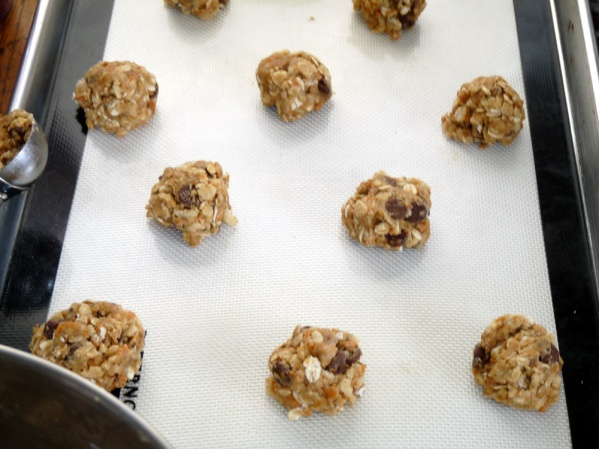 Use a small cookie scoop to make balls of dough and place them on parchment line baking sheet. I used a silpat then discovered they baked just great on an ungreased baking sheet.