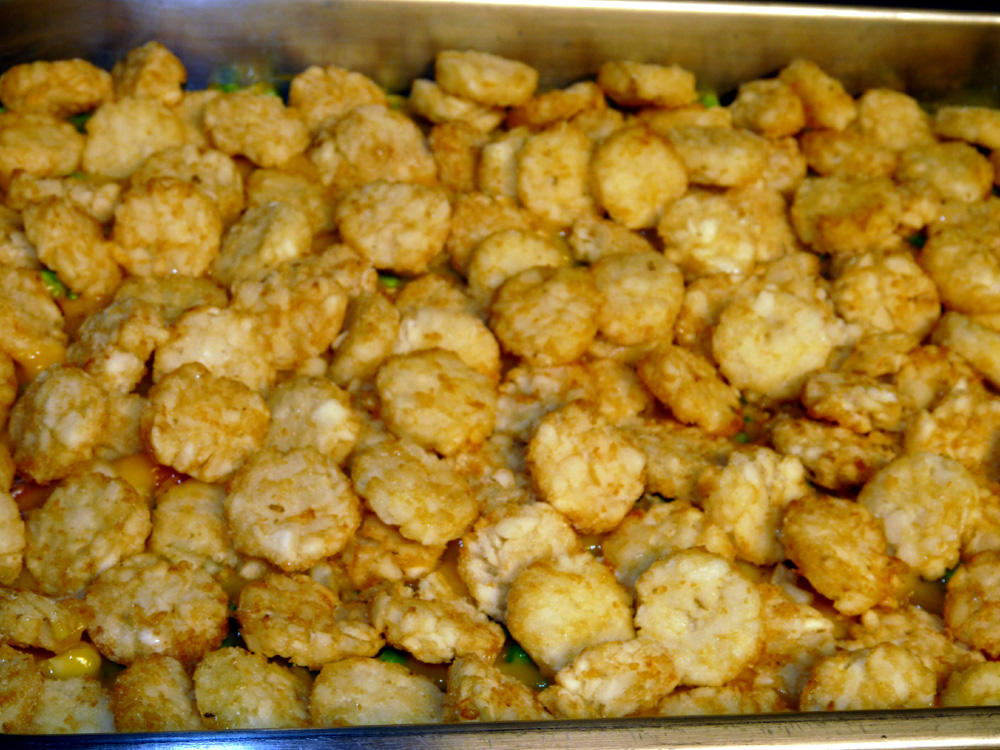 Layer bag of tater tots or tater rounds over the top. Place in preheated 400°F oven.