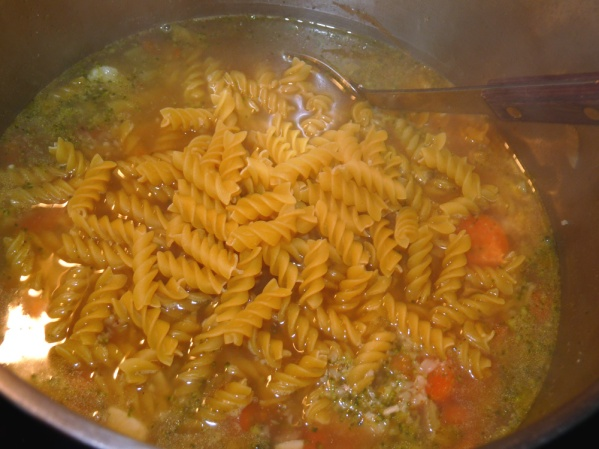 Add 8 oz rotini to pot and stir well. Cook at medium low until past is al dente, 10-15 minutes.