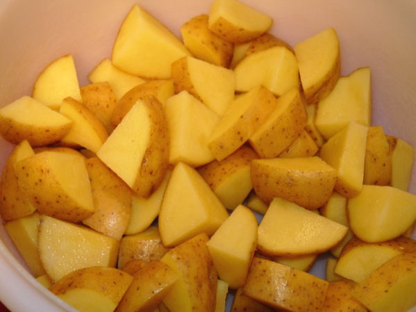 Scrub and cut potatoes into smaller pieces. I used Yukon Gold potatoes.
