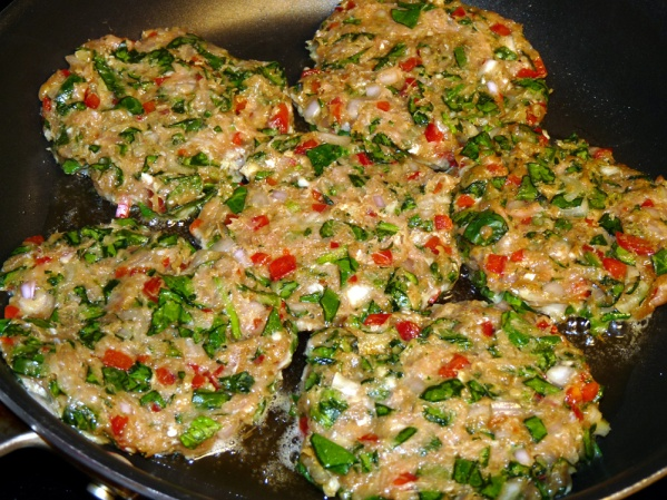 Place chicken patties in skillet and fry until browned on first side, about 5 minutes.