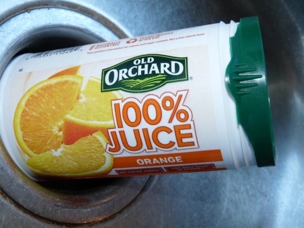 I keep can of orange juice concentrate handy in the freezer for uses like this one. I spooned 2 tablespoons of concentrate into the skillet. I also added a teaspoon of minced garlic and ginger I buy together in a jar.