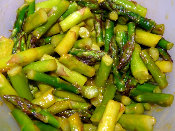Pour sauce over asparagus and toss to coat. Add oranges, toss again and serve in bowls.