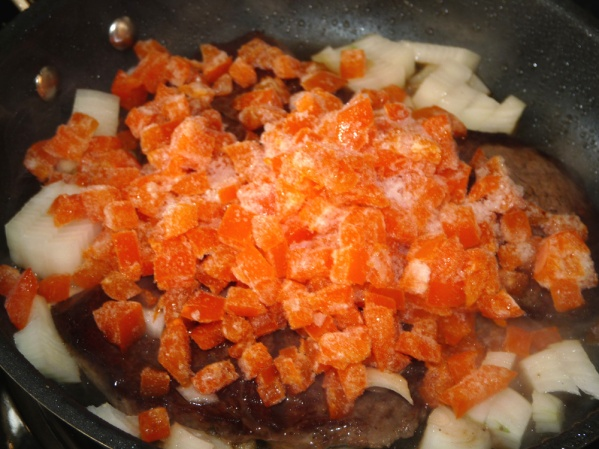 Add another drizzle of oil to the skillet and fry onions and peppers for several minutes.