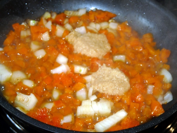 Add minced garlic and ginger and fry for a couple more minutes, stirring constantly.