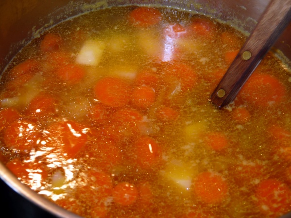 Strain broth and return to pot. Add minced garlic and bring to a boil. Add carrots, onion and celery. Bring to a boil and reduce heat to medium low. Simmer until carrots are just fork tender, about 20 minutes.