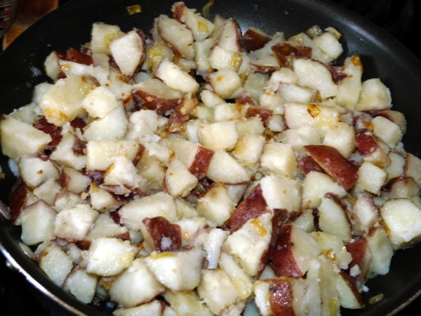 Add cooled potatoes to skillet and carefully stir until well mixed.