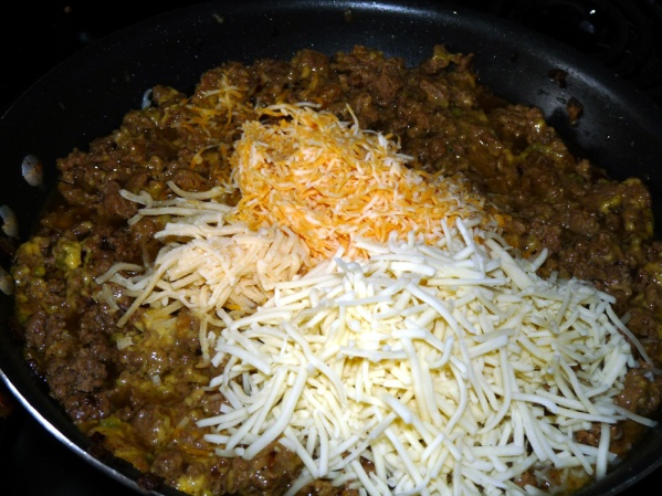 Add cheeses and stir well.
