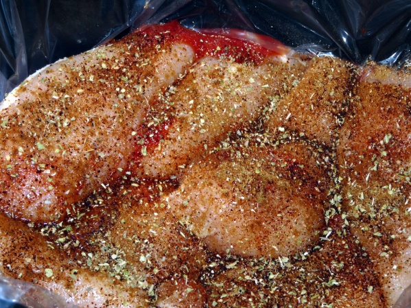 Layer tomato sauce, chicken breasts and seasonings in the crockpot