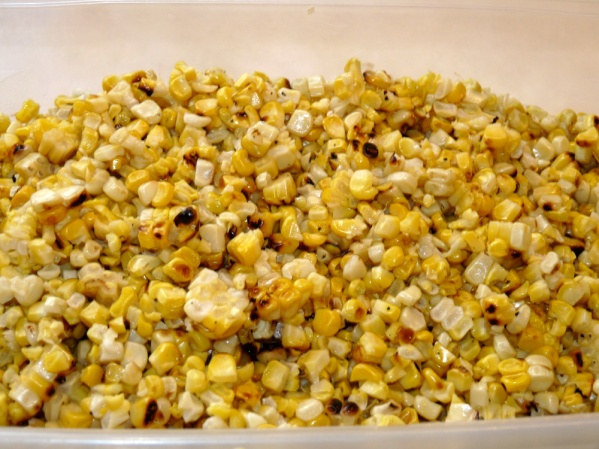 Slice corn from ears and place in bowl