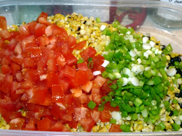 Add chopped green onion, red onion and chopped tomatoes to bowl.