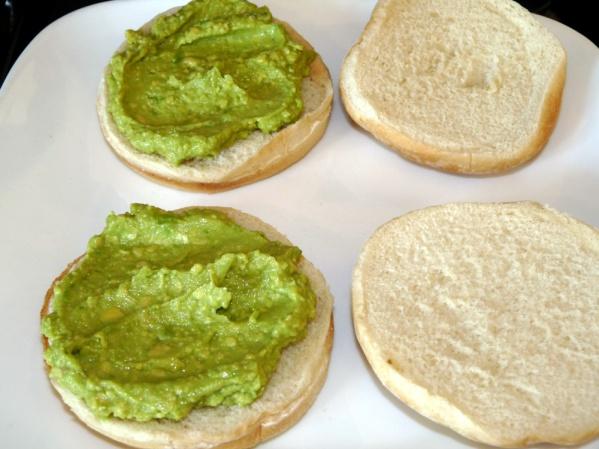 Spread avocado on bottom buns.