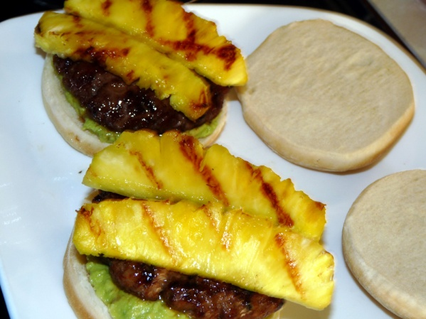 Place burgers on top of avocado spread. Top with pineapple slices.