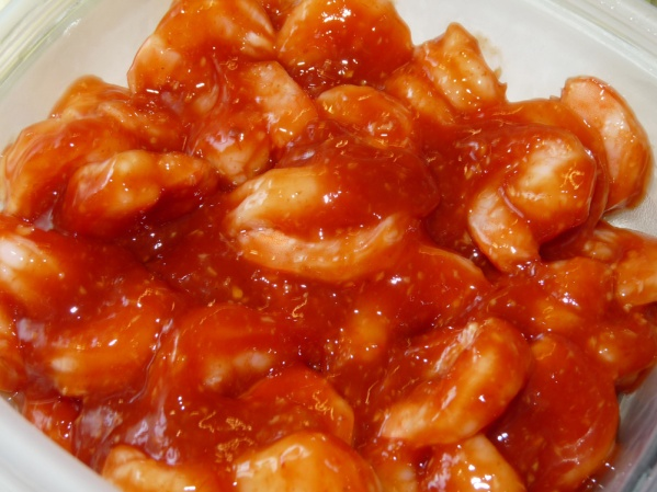 Thaw shrimp, peel and clean and toss with half of cocktail sauce.